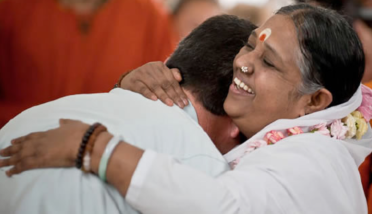 Amma-embracing-devotee